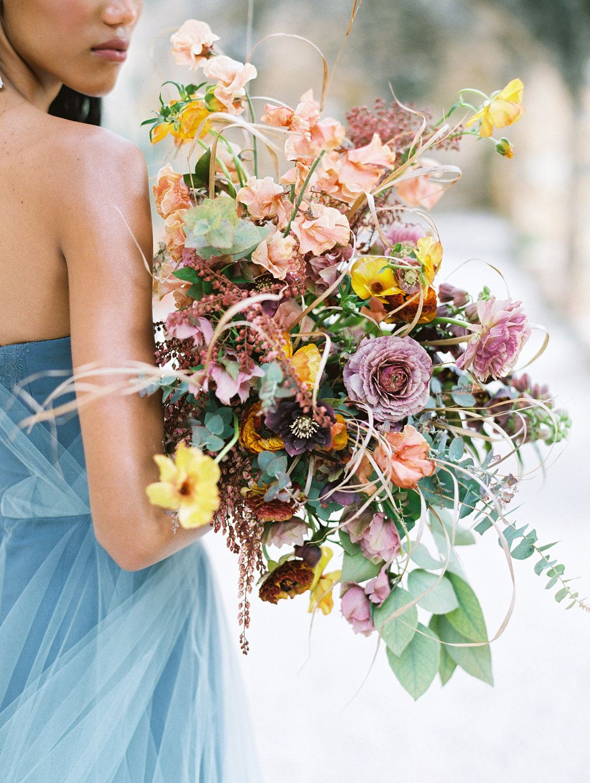 wild lush wedding bouquets - photo by Charla Storey https://ruffledblog.com/architectural-san-antonio-mission-wedding-inspiration