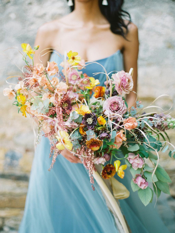 yellow and pink wedding bouquets - photo by Charla Storey https://ruffledblog.com/architectural-san-antonio-mission-wedding-inspiration