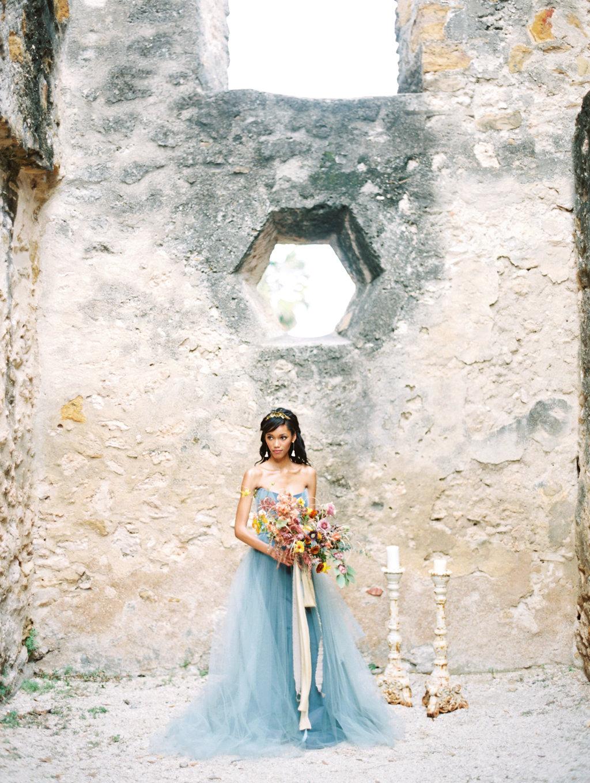 romantic bridal portraits - photo by Charla Storey https://ruffledblog.com/architectural-san-antonio-mission-wedding-inspiration