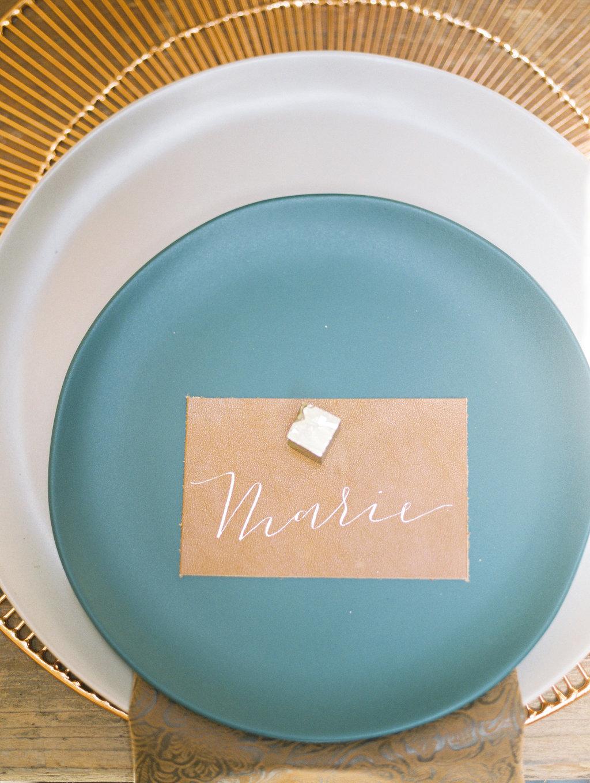 blue wedding plates - photo by Charla Storey https://ruffledblog.com/architectural-san-antonio-mission-wedding-inspiration