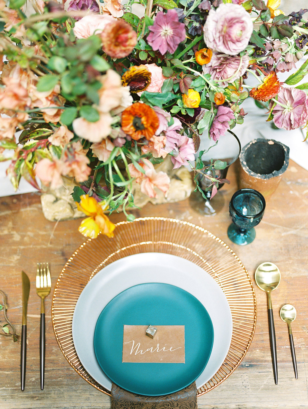 colorful floral place settings - photo by Charla Storey https://ruffledblog.com/architectural-san-antonio-mission-wedding-inspiration
