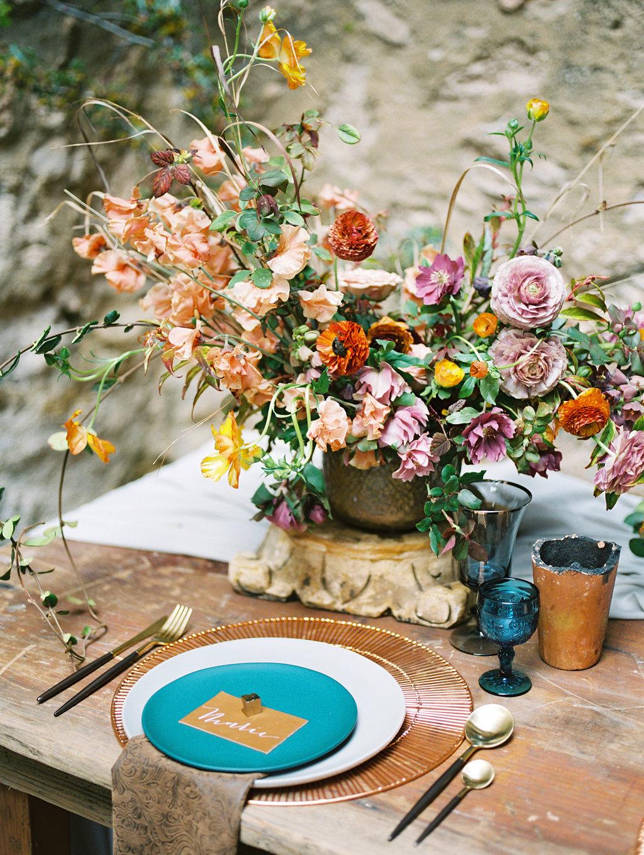 romantic place settings with blue - photo by Charla Storey https://ruffledblog.com/architectural-san-antonio-mission-wedding-inspiration