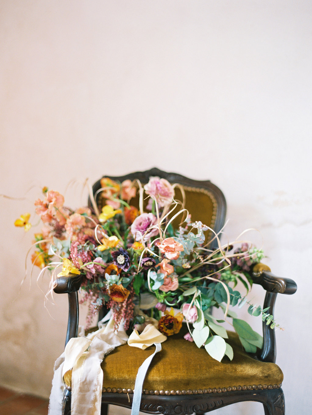 wild lush bouquets - photo by Charla Storey http://ruffledblog.com/architectural-san-antonio-mission-wedding-inspiration