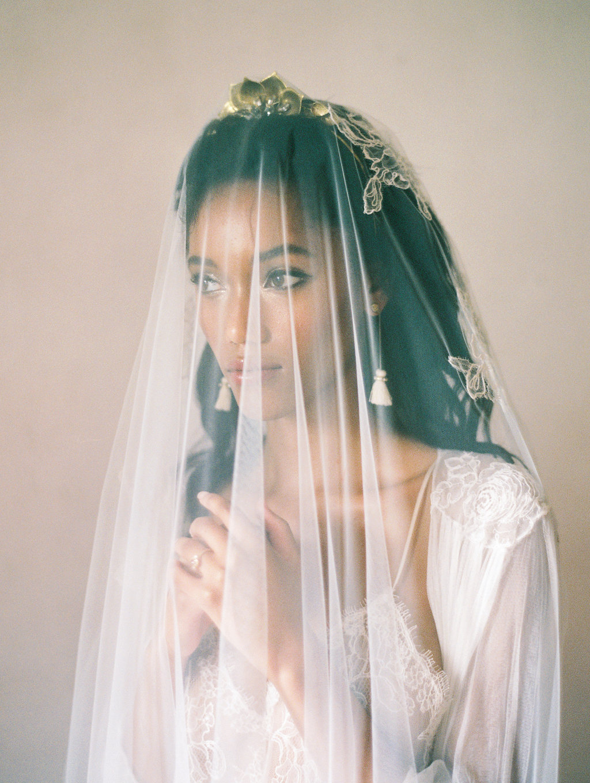 bridal boudoir with veils - photo by Charla Storey https://ruffledblog.com/architectural-san-antonio-mission-wedding-inspiration