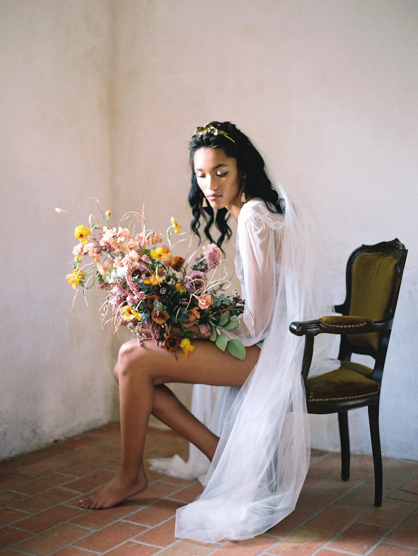 romantic bridal boudoir portraits - photo by Charla Storey https://ruffledblog.com/architectural-san-antonio-mission-wedding-inspiration