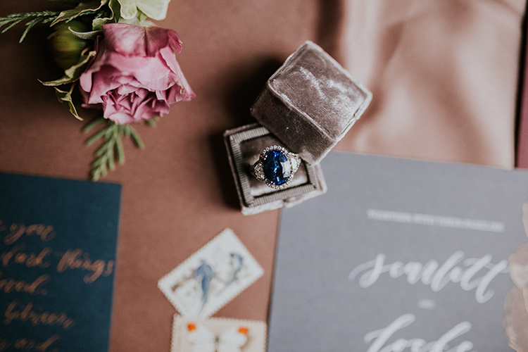 sapphire and diamond engagement rings - https://ruffledblog.com/artist-inspired-wedding-ideas-with-oxblood-and-navy