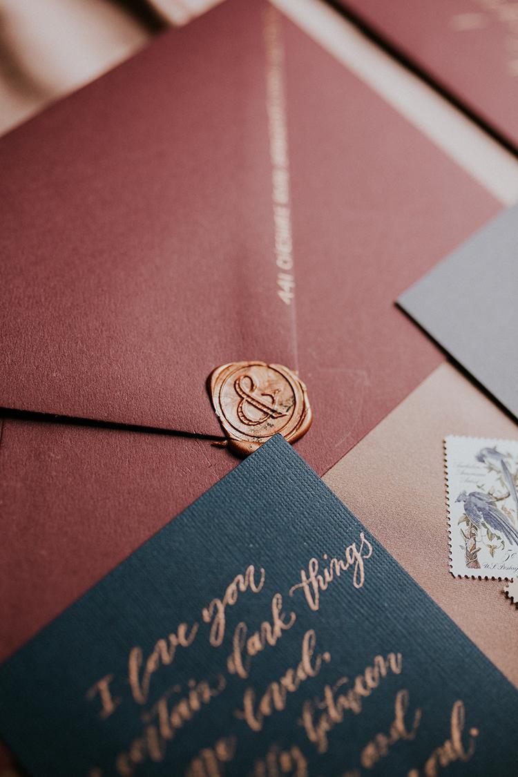 wedding invitation wax seals - https://ruffledblog.com/artist-inspired-wedding-ideas-with-oxblood-and-navy