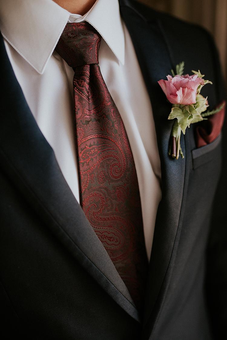 red tie groom looks - https://ruffledblog.com/artist-inspired-wedding-ideas-with-oxblood-and-navy