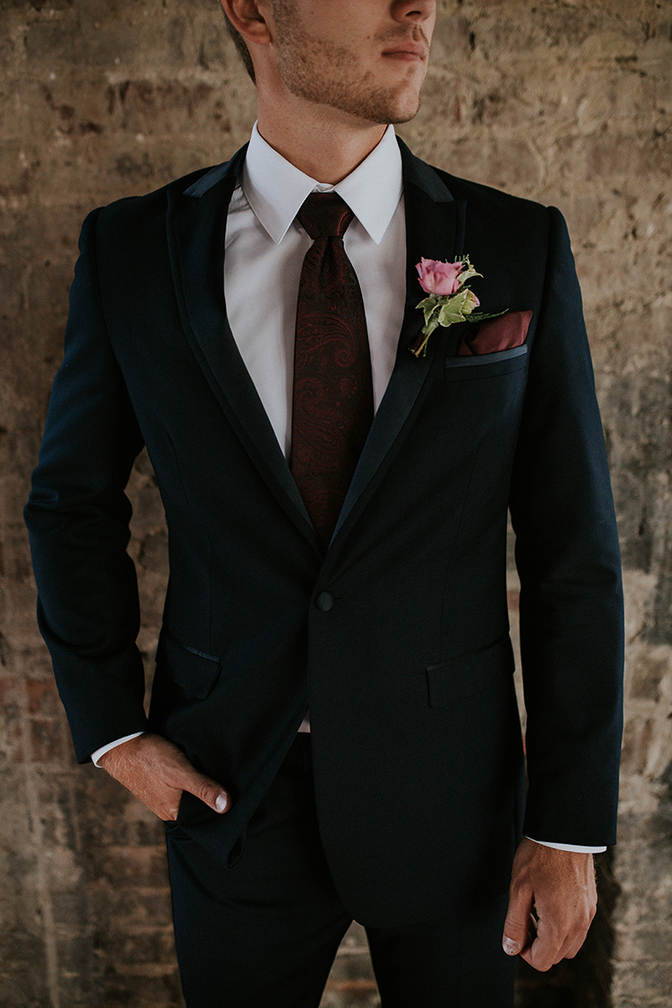 chic groom suits - https://ruffledblog.com/artist-inspired-wedding-ideas-with-oxblood-and-navy