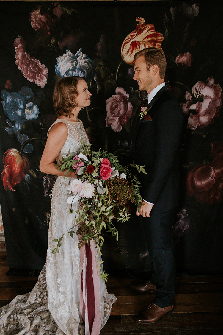 dramatic wedding inspiration - https://ruffledblog.com/artist-inspired-wedding-ideas-with-oxblood-and-navy