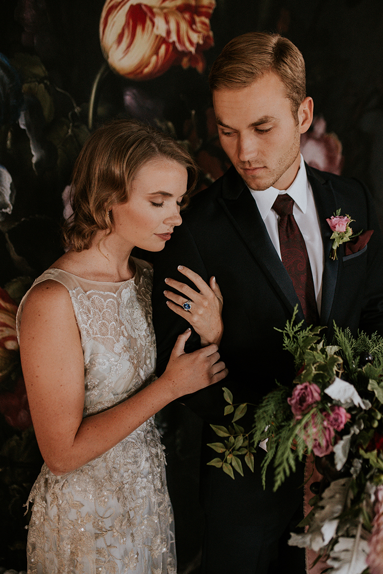 dramatic floral wedding inspiration - https://ruffledblog.com/artist-inspired-wedding-ideas-with-oxblood-and-navy