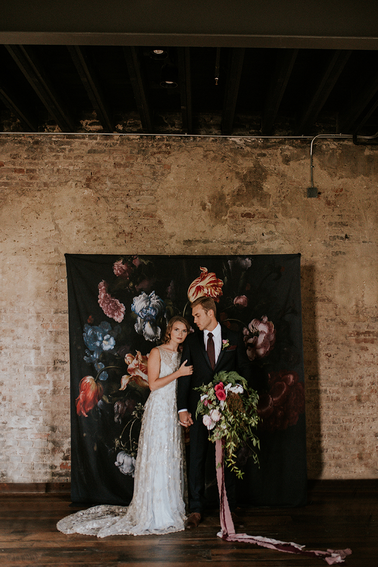 floral wallpaper backdrops - https://ruffledblog.com/artist-inspired-wedding-ideas-with-oxblood-and-navy