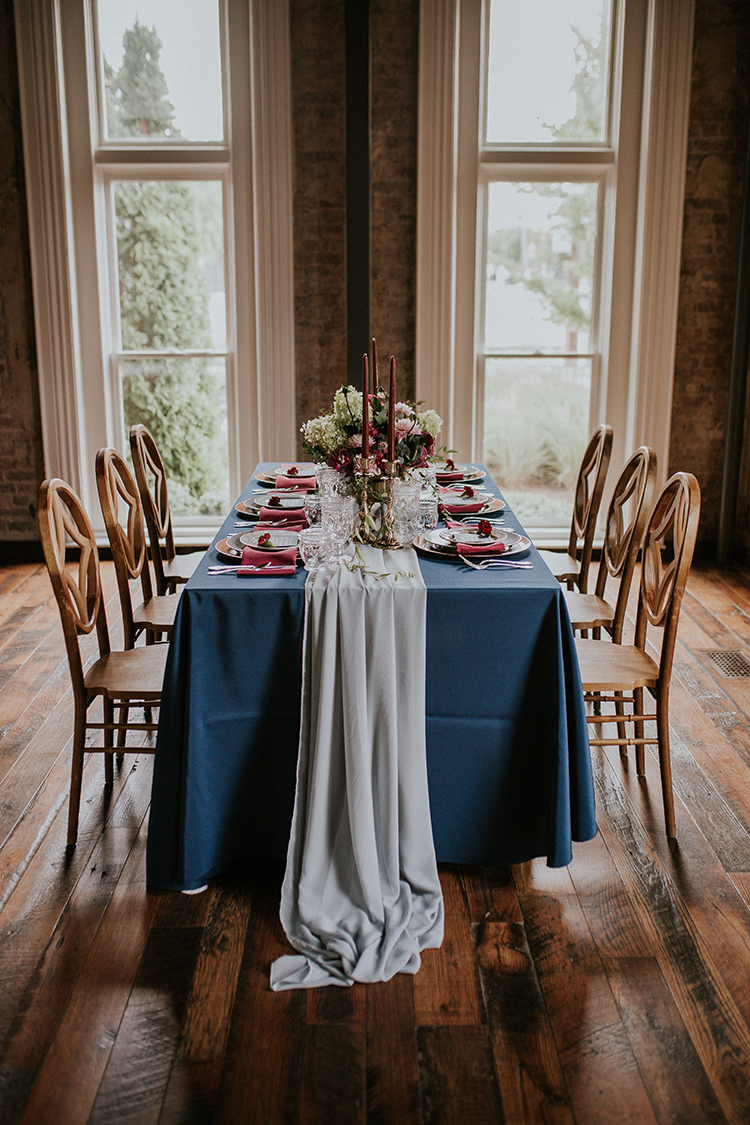 wedding tables with shades of blue - https://ruffledblog.com/artist-inspired-wedding-ideas-with-oxblood-and-navy