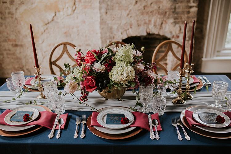 vintage inspired wedding tables - https://ruffledblog.com/artist-inspired-wedding-ideas-with-oxblood-and-navy