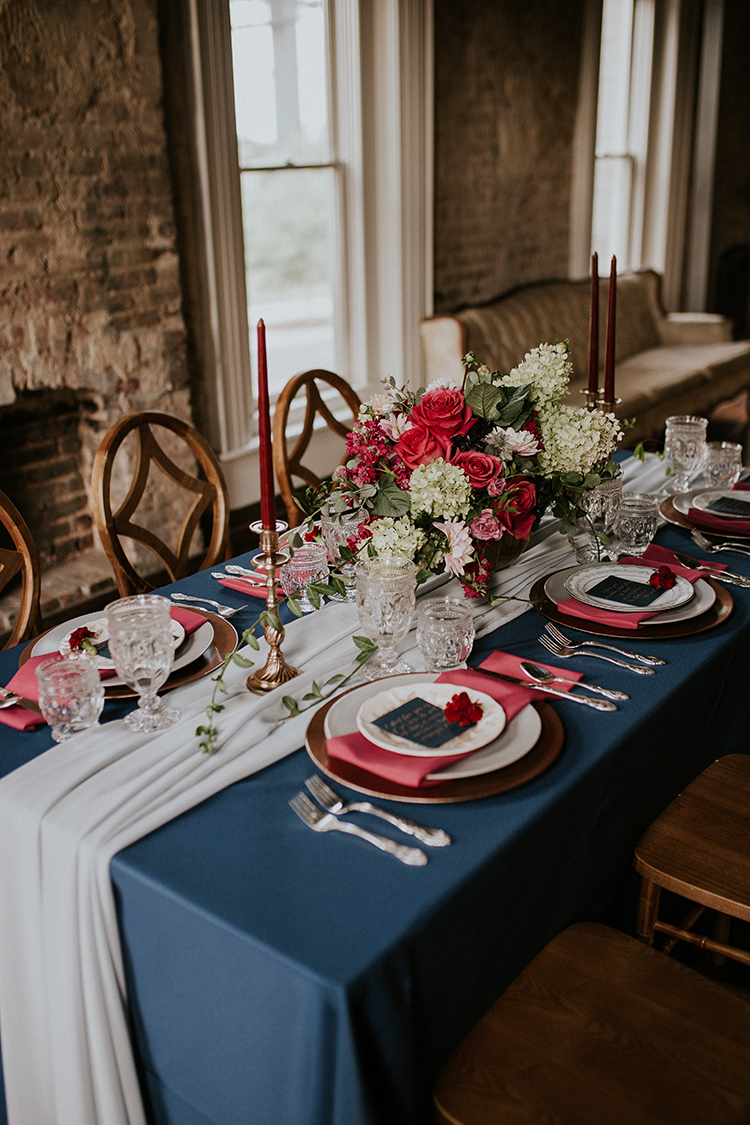 blue and red wedding tables - https://ruffledblog.com/artist-inspired-wedding-ideas-with-oxblood-and-navy