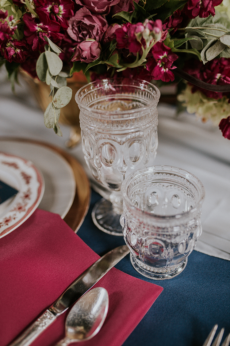vintage inspired wedding table details - https://ruffledblog.com/artist-inspired-wedding-ideas-with-oxblood-and-navy
