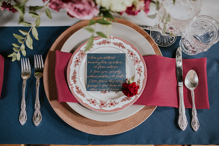vintage inspired blue and red tables - https://ruffledblog.com/artist-inspired-wedding-ideas-with-oxblood-and-navy