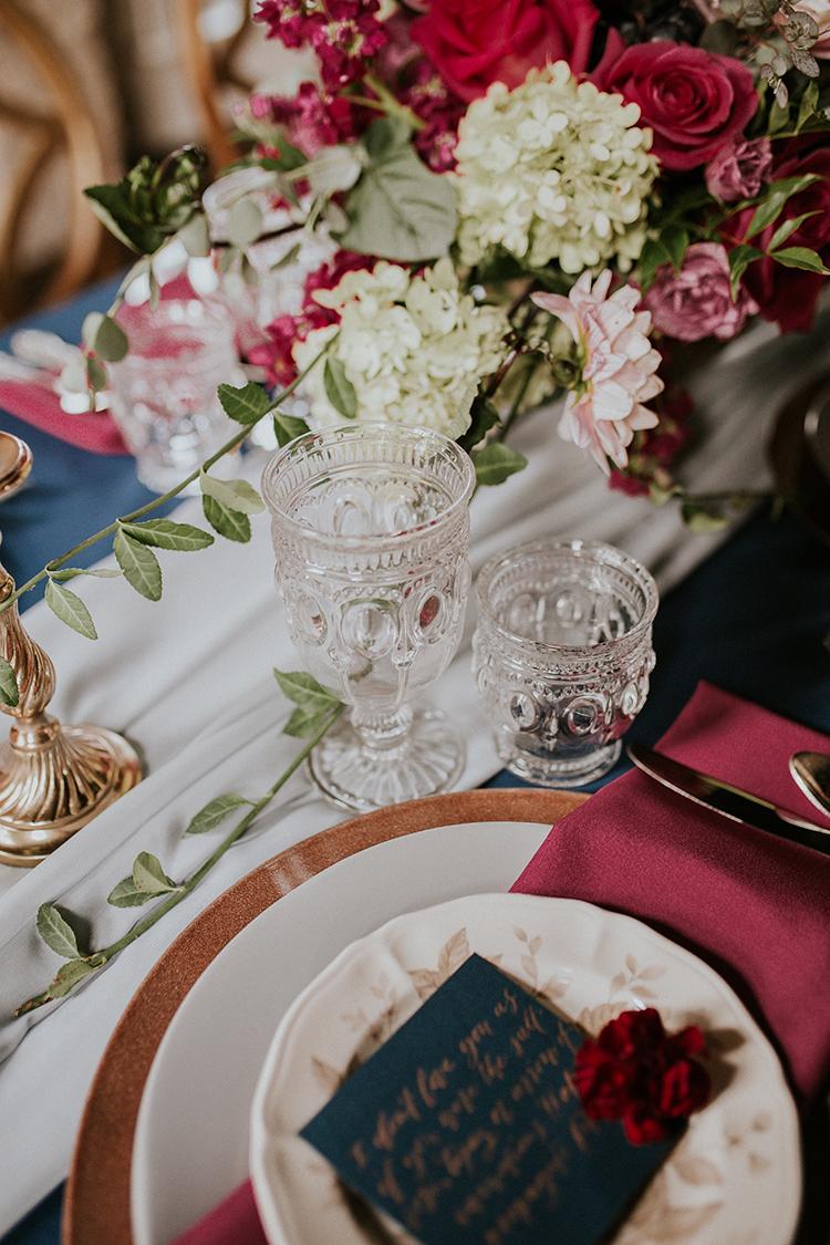 vintage inspired wedding glasses - https://ruffledblog.com/artist-inspired-wedding-ideas-with-oxblood-and-navy