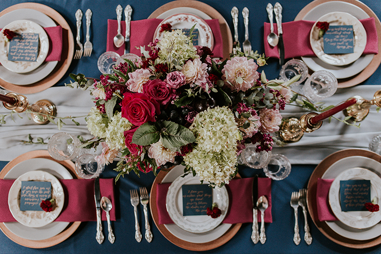 vintage inspired red and blue tablescapes - https://ruffledblog.com/artist-inspired-wedding-ideas-with-oxblood-and-navy