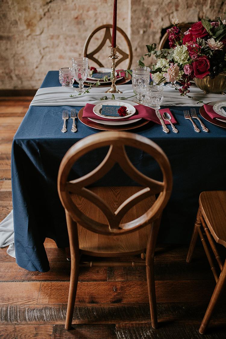 wedding chairs for a geometric wedding - https://ruffledblog.com/artist-inspired-wedding-ideas-with-oxblood-and-navy