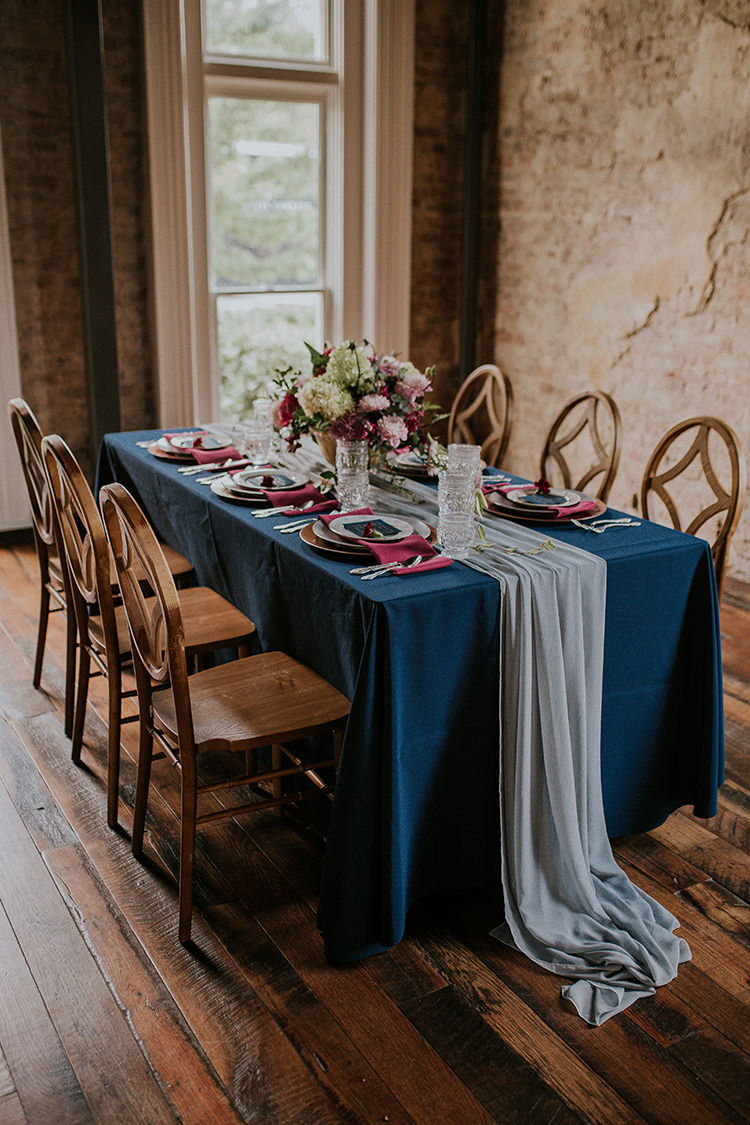romantic blue tablescapes - https://ruffledblog.com/artist-inspired-wedding-ideas-with-oxblood-and-navy