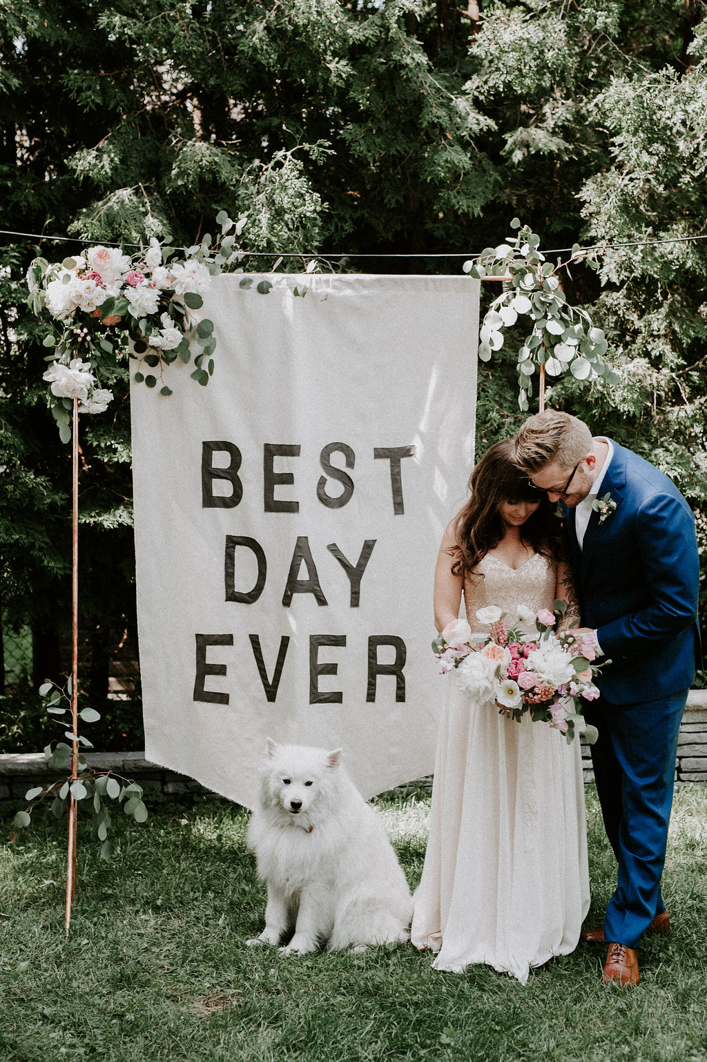 Backyard Wedding at Home with a Banner Backdrop - http://ruffledblog.com/backyard-wedding-at-home-with-a-banner-backdrop