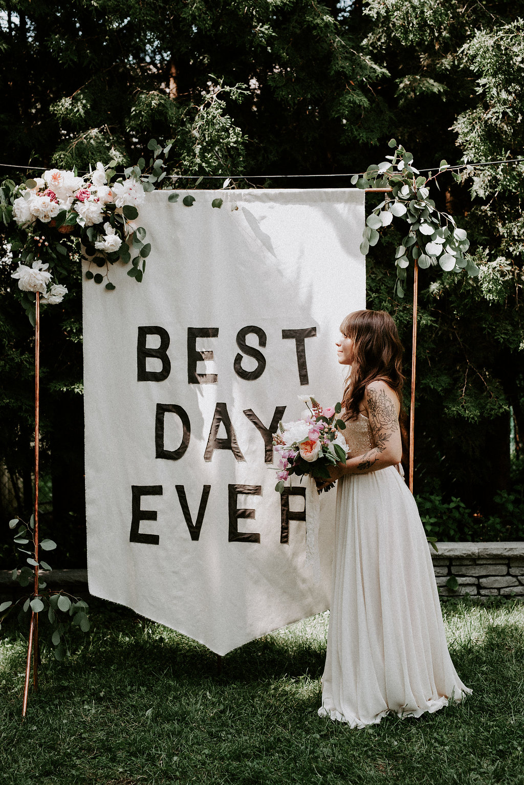 backyard wedding at home with a banner backdrop ruffled