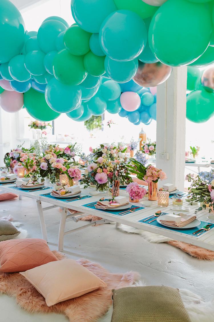 balloon garland wedding decor ideas - photo by Beck Rocchi https://ruffledblog.com/balloon-filled-party-inspiration-at-a-pandora-brunch