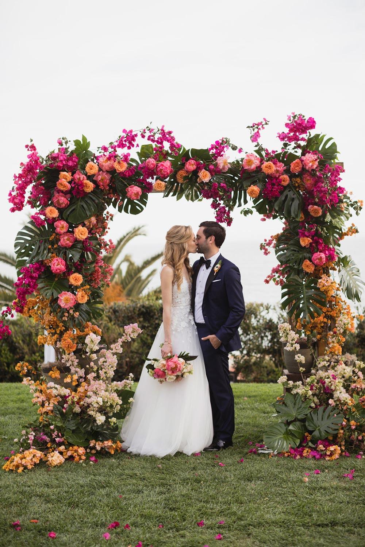 floral appliqué wedding dress with navy groom tuxedo