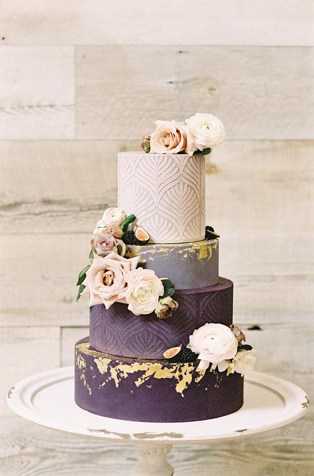 plum and pink wedding cake with gold foil