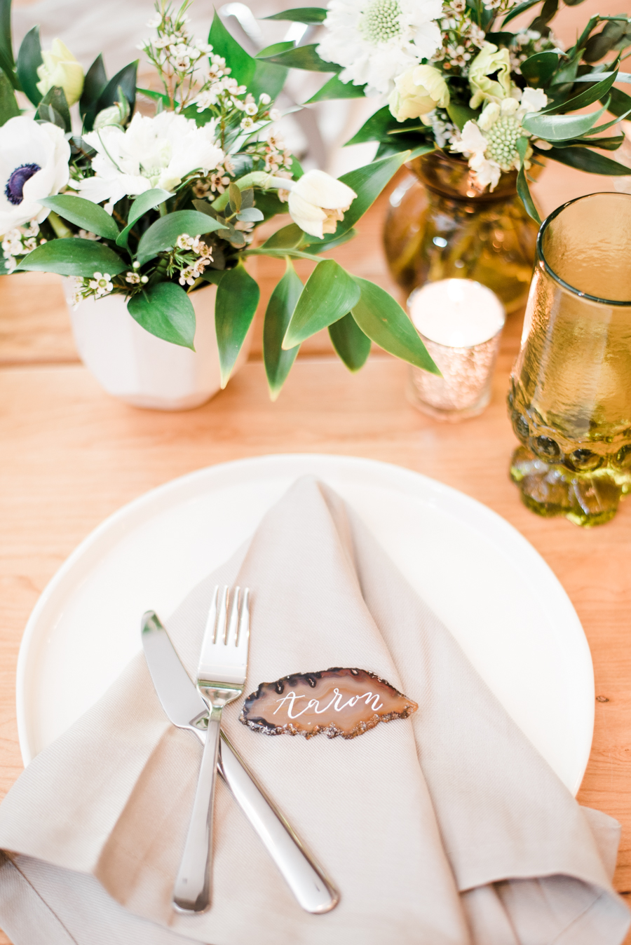 place settings - photo by Maggie Mills Photography http://ruffledblog.com/romantic-southern-wedding-inspiration-in-charlotte