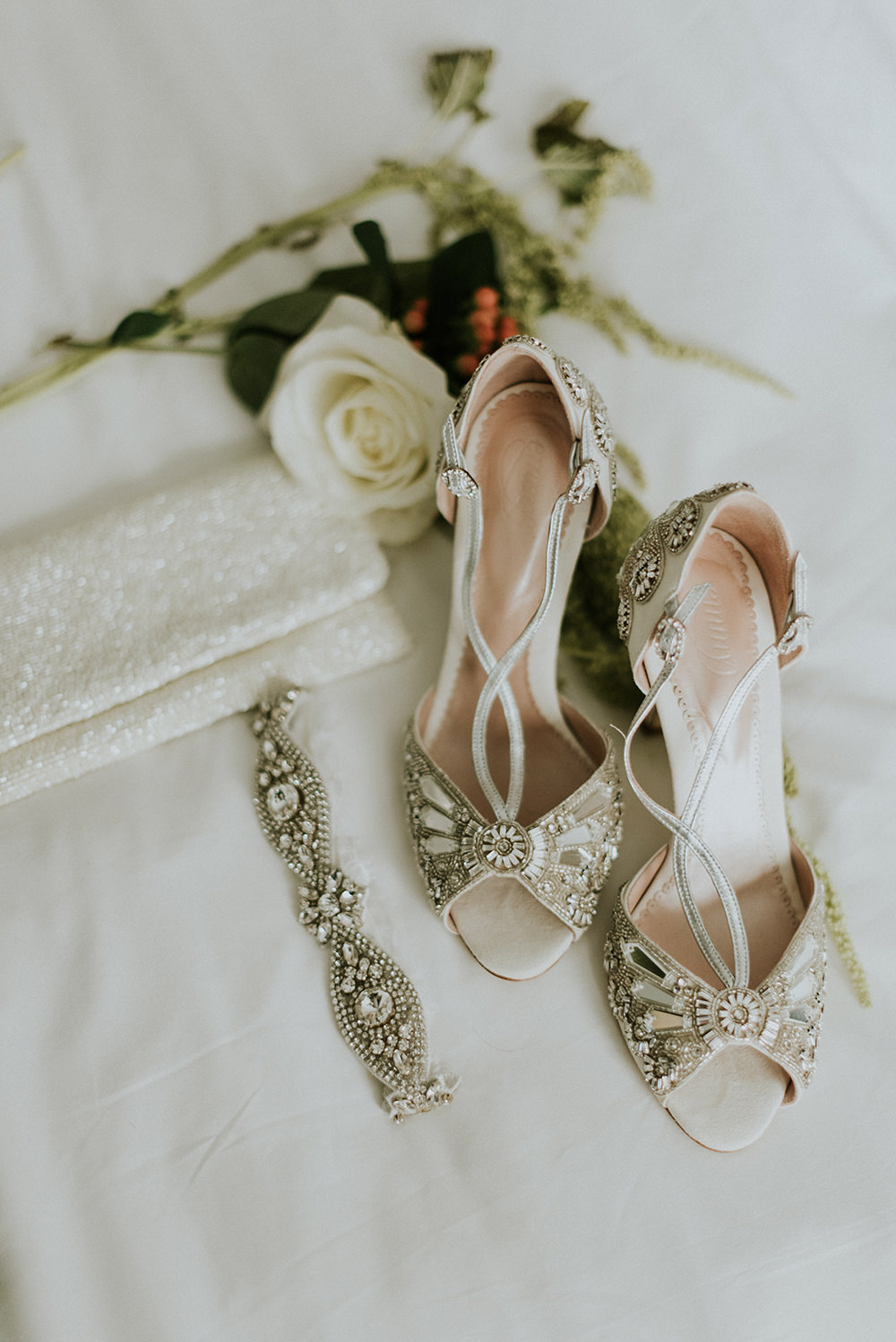 bejeweled wedding shoes - photo by M2 Photography https://ruffledblog.com/black-tie-philadelphia-wedding-with-a-boho-twist