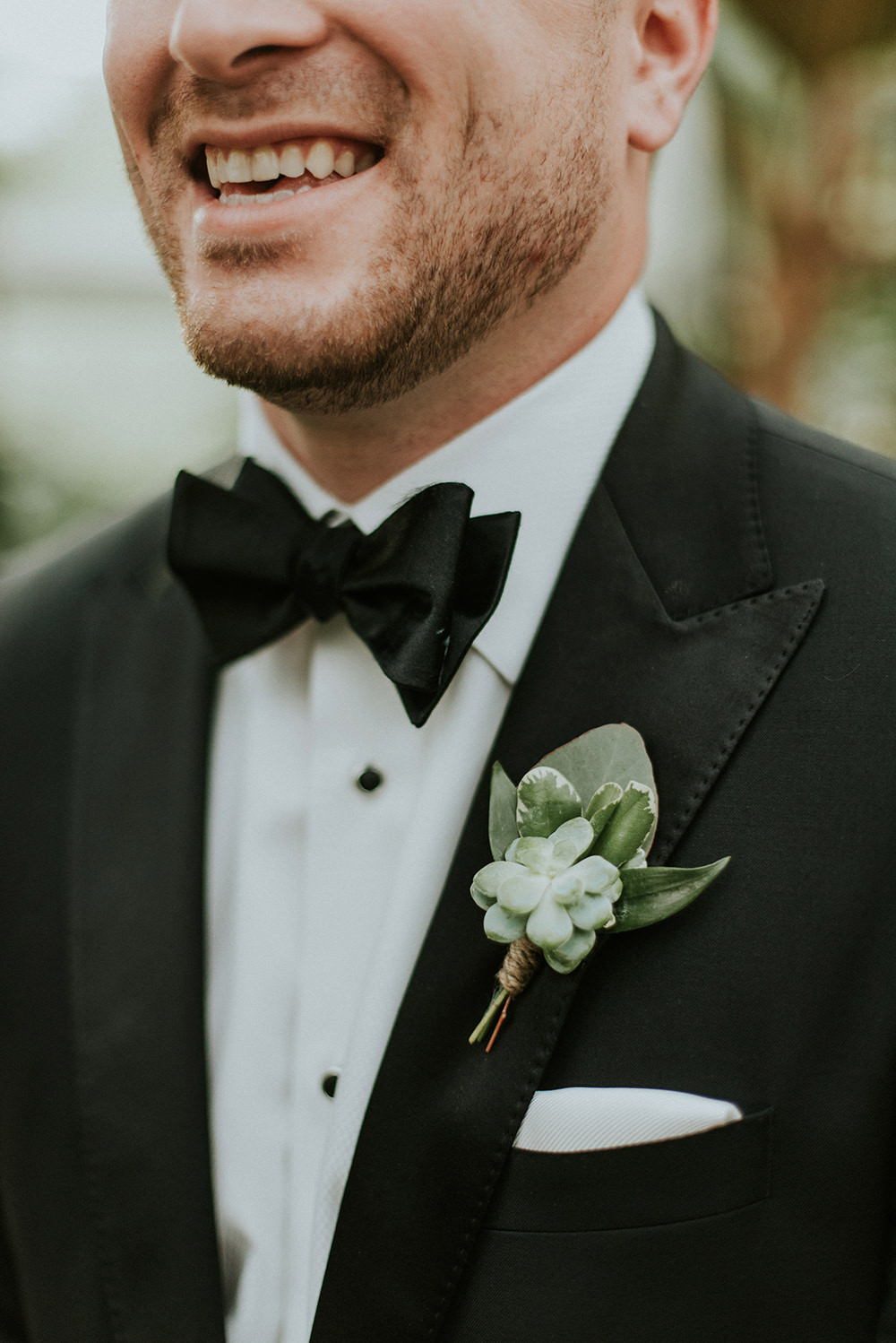 greenery boutonnieres - photo by M2 Photography https://ruffledblog.com/black-tie-philadelphia-wedding-with-a-boho-twist