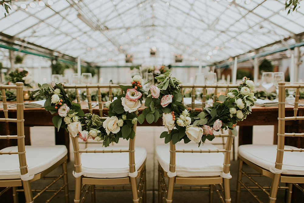 sweetheart table chairs - photo by M2 Photography https://ruffledblog.com/black-tie-philadelphia-wedding-with-a-boho-twist