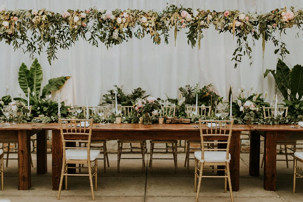 wedding tables - photo by M2 Photography http://ruffledblog.com/black-tie-philadelphia-wedding-with-a-boho-twist