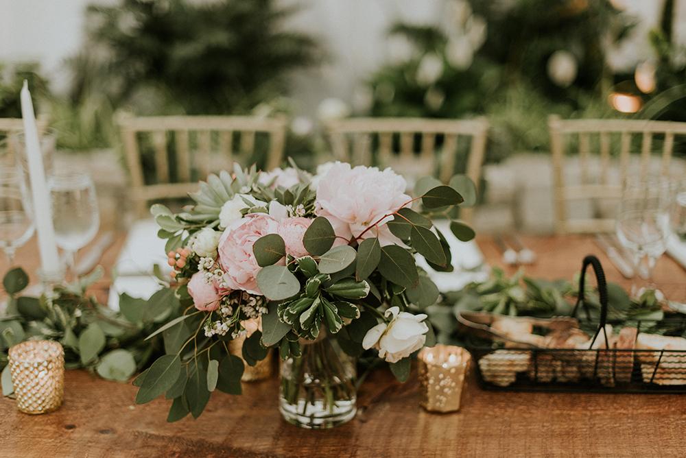 wedding centerpieces - photo by M2 Photography http://ruffledblog.com/black-tie-philadelphia-wedding-with-a-boho-twist
