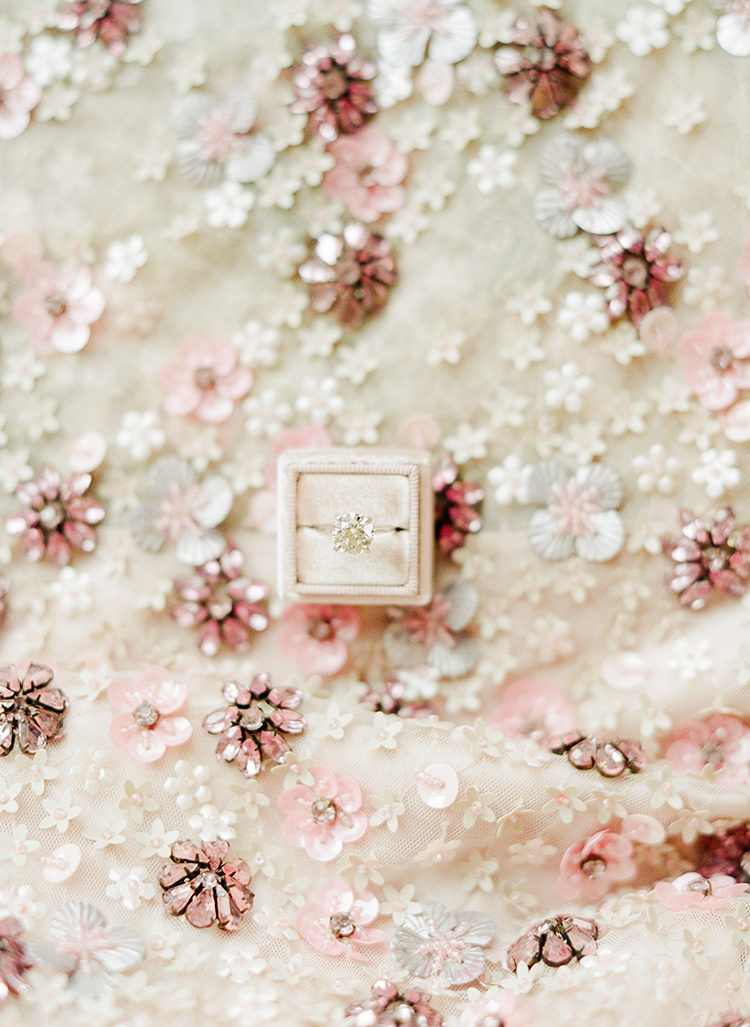 cushion cut engagment rings - photo by Lisa Blume Photography http://ruffledblog.com/black-tie-washington-dc-wedding-with-a-floral-wall