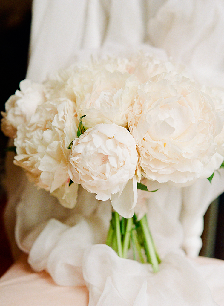 ivory peony bouquets - photo by Lisa Blume Photography http://ruffledblog.com/black-tie-washington-dc-wedding-with-a-floral-wall