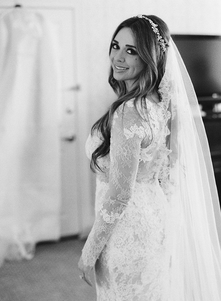 lace wedding dresses - photo by Lisa Blume Photography http://ruffledblog.com/black-tie-washington-dc-wedding-with-a-floral-wall
