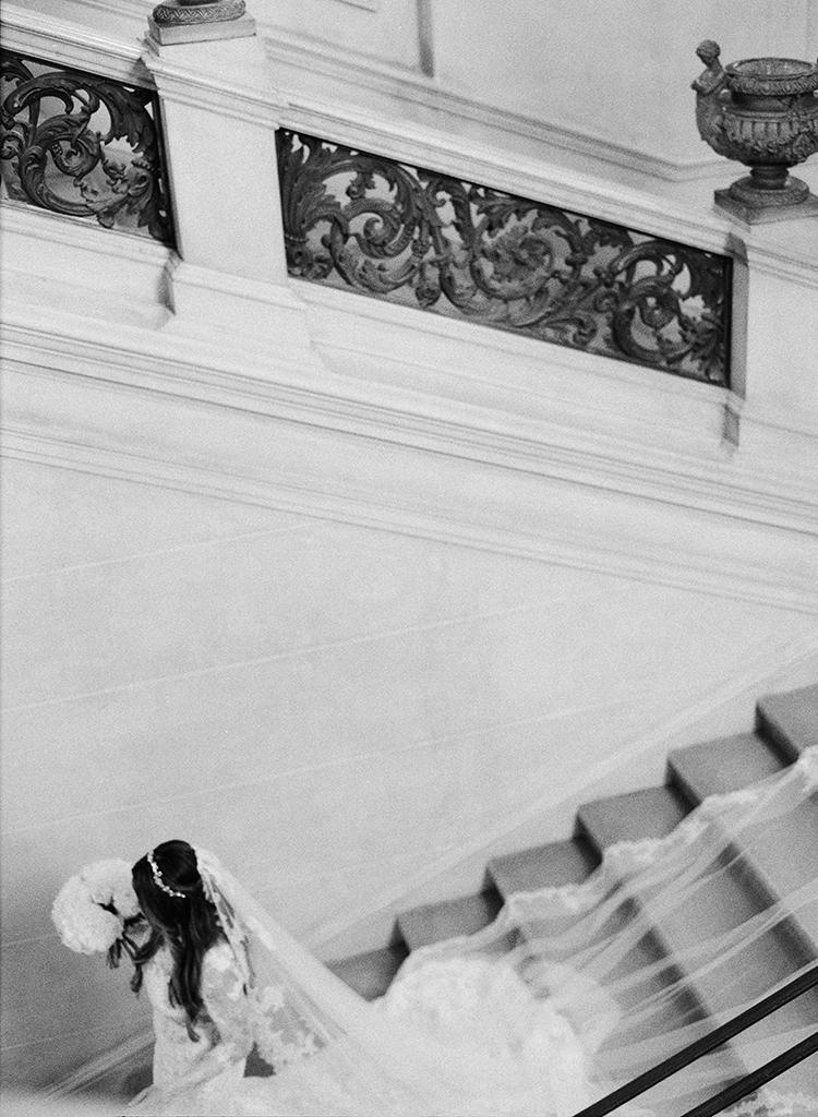 bride getting ready - photo by Lisa Blume Photography https://ruffledblog.com/black-tie-washington-dc-wedding-with-a-floral-wall