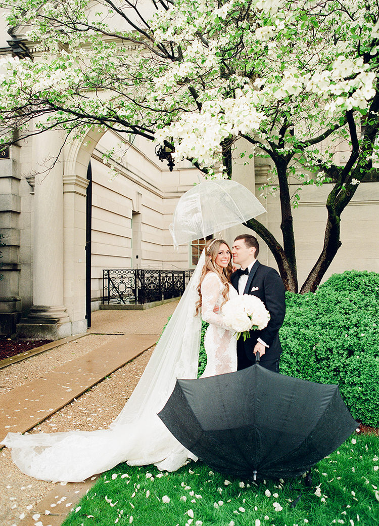 cute wedding photography - photo by Lisa Blume Photography http://ruffledblog.com/black-tie-washington-dc-wedding-with-a-floral-wall