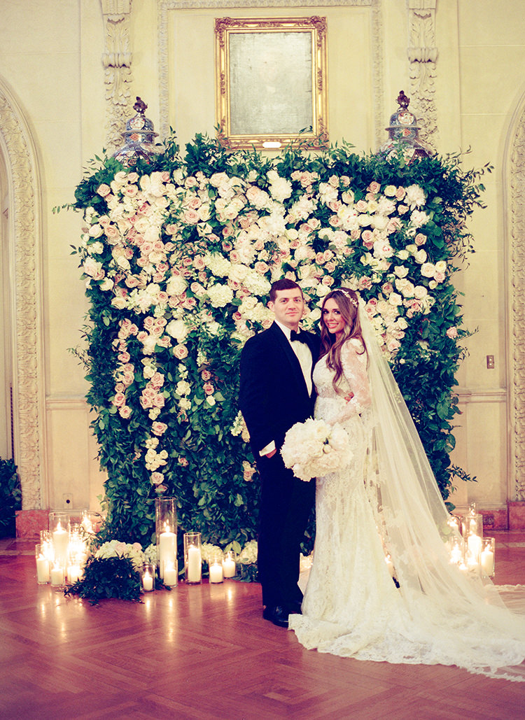 floral wedding walls - photo by Lisa Blume Photography https://ruffledblog.com/black-tie-washington-dc-wedding-with-a-floral-wall