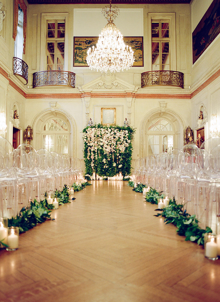 indoor wedding ceremonies with floral walls - photo by Lisa Blume Photography https://ruffledblog.com/black-tie-washington-dc-wedding-with-a-floral-wall