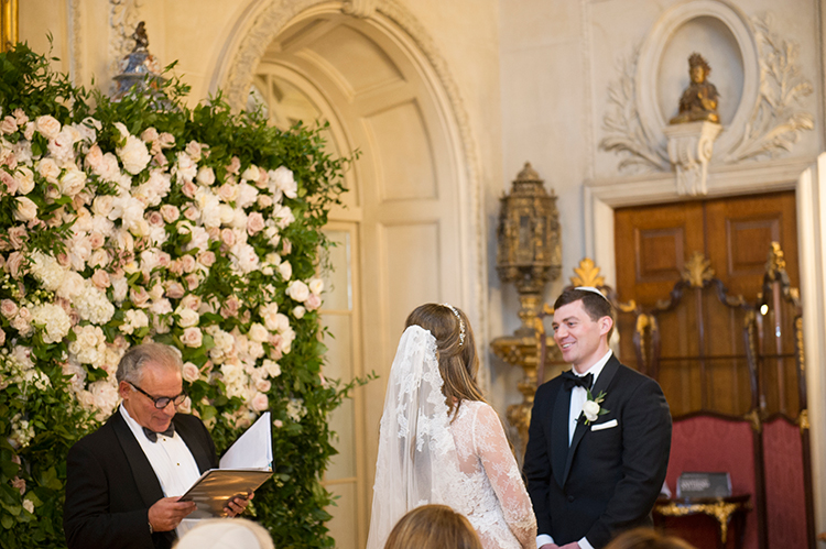 wedding ceremony - photo by Lisa Blume Photography http://ruffledblog.com/black-tie-washington-dc-wedding-with-a-floral-wall