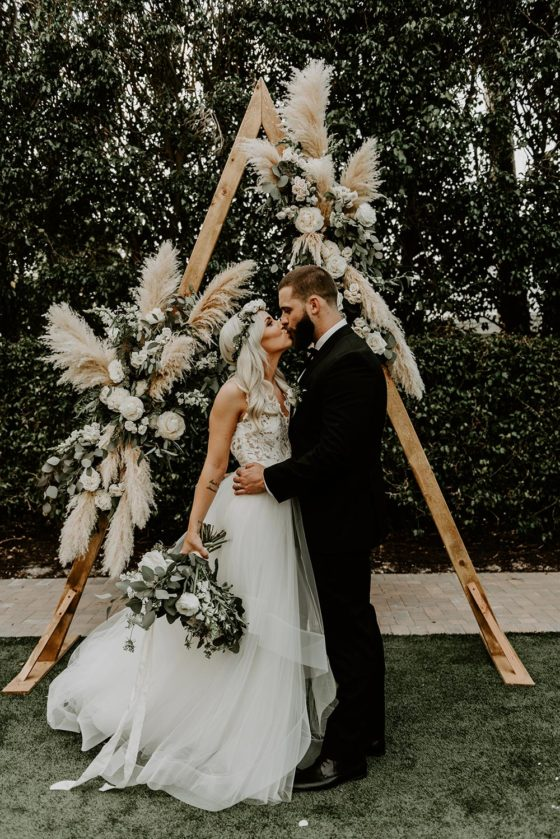Bohemian Sage Green Wedding with a Geometric Pampas Grass Backdrop