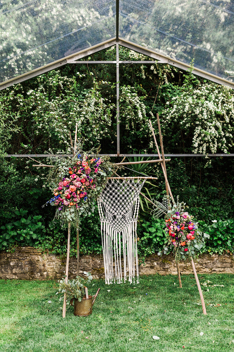 bohemian wedding ceremony decor - photo by Passionate http://ruffledblog.com/bohemian-wedding-in-portugal-with-bright-flowers-everywhere