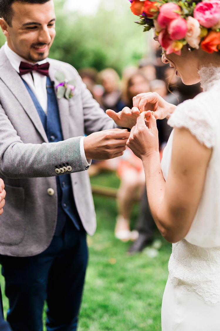 wedding ring exchange - photo by Passionate https://ruffledblog.com/bohemian-wedding-in-portugal-with-bright-flowers-everywhere