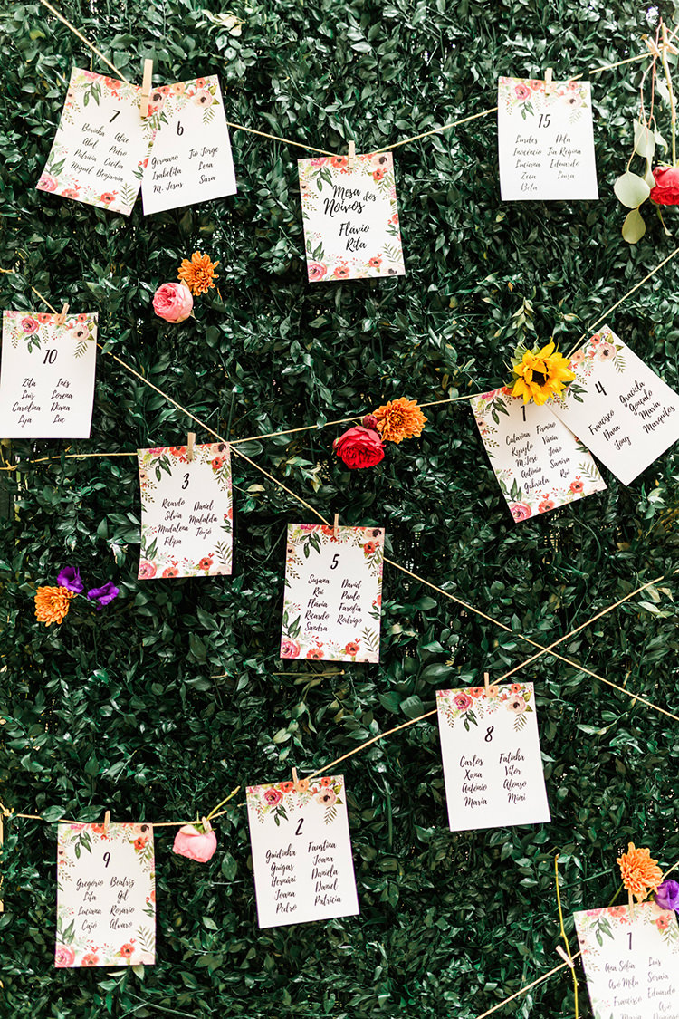 seating charts - photo by Passionate http://ruffledblog.com/bohemian-wedding-in-portugal-with-bright-flowers-everywhere