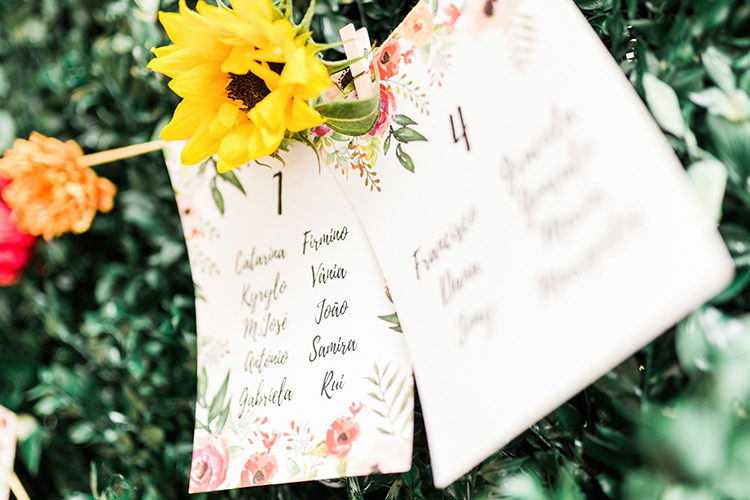 paper seating charts - photo by Passionate http://ruffledblog.com/bohemian-wedding-in-portugal-with-bright-flowers-everywhere