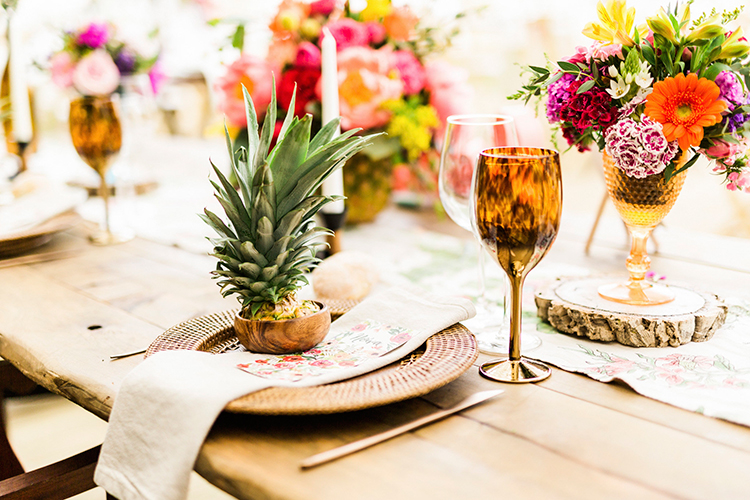 tropical wedding place settings - photo by Passionate http://ruffledblog.com/bohemian-wedding-in-portugal-with-bright-flowers-everywhere